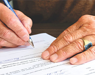judge-signing-a-document