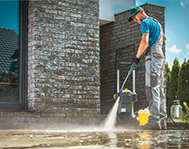 man-cleaning-the-floor-with-pressure-wash