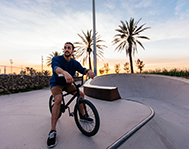 man-riding-his-bicycle-riverside-county