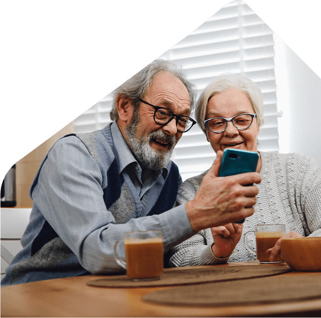 older couple checking rent payments using mobile