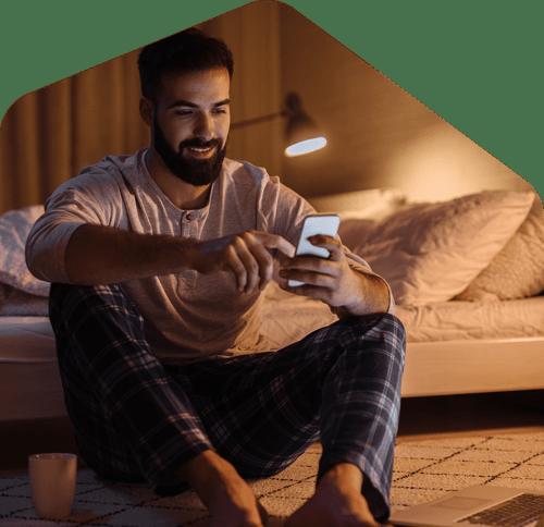 renter enjoy using smartphone at bed