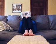renter-sitting-couch-reading-magazine