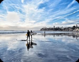 couple walking in beach in san diego