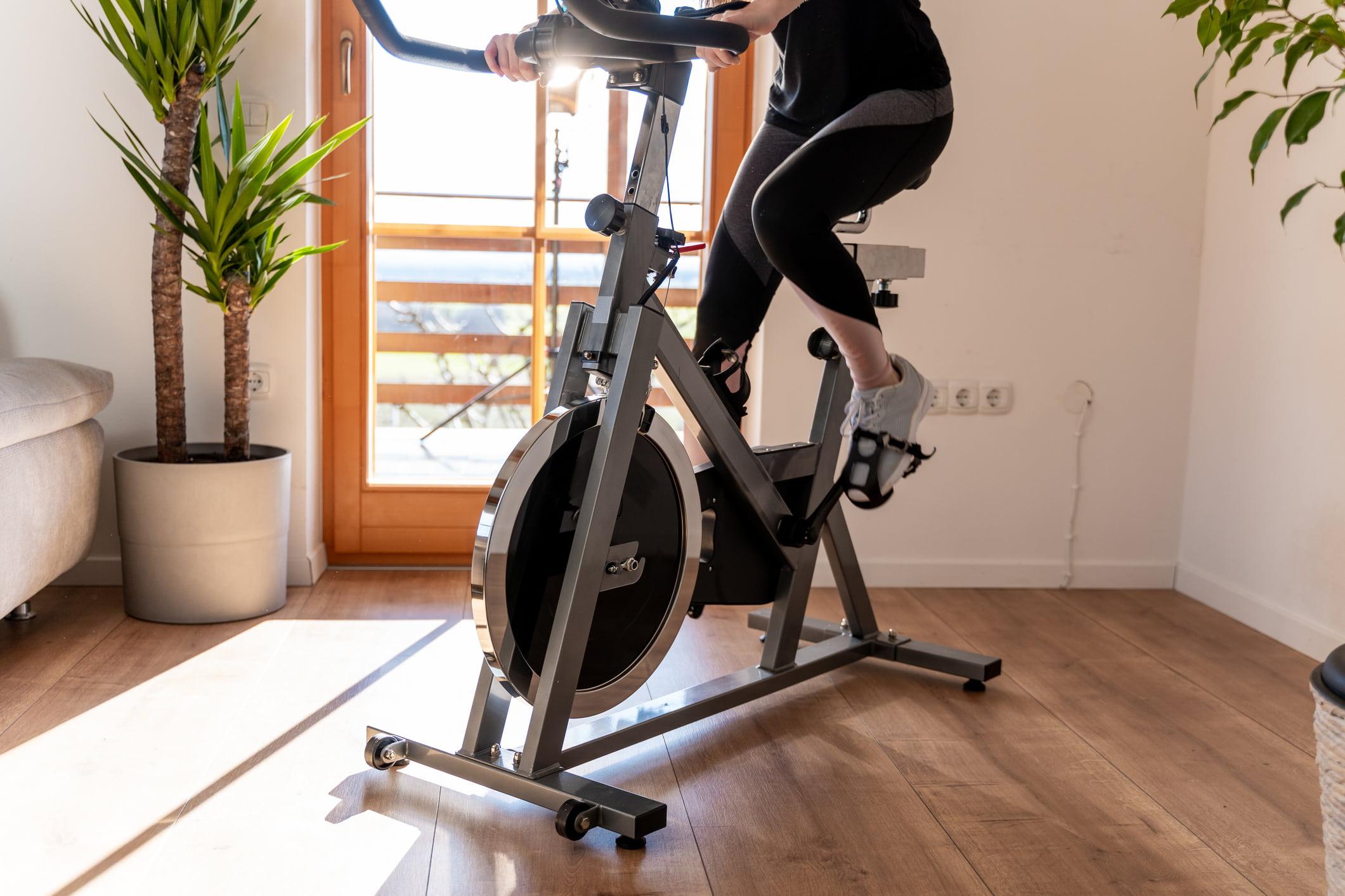 woman using peloton at home